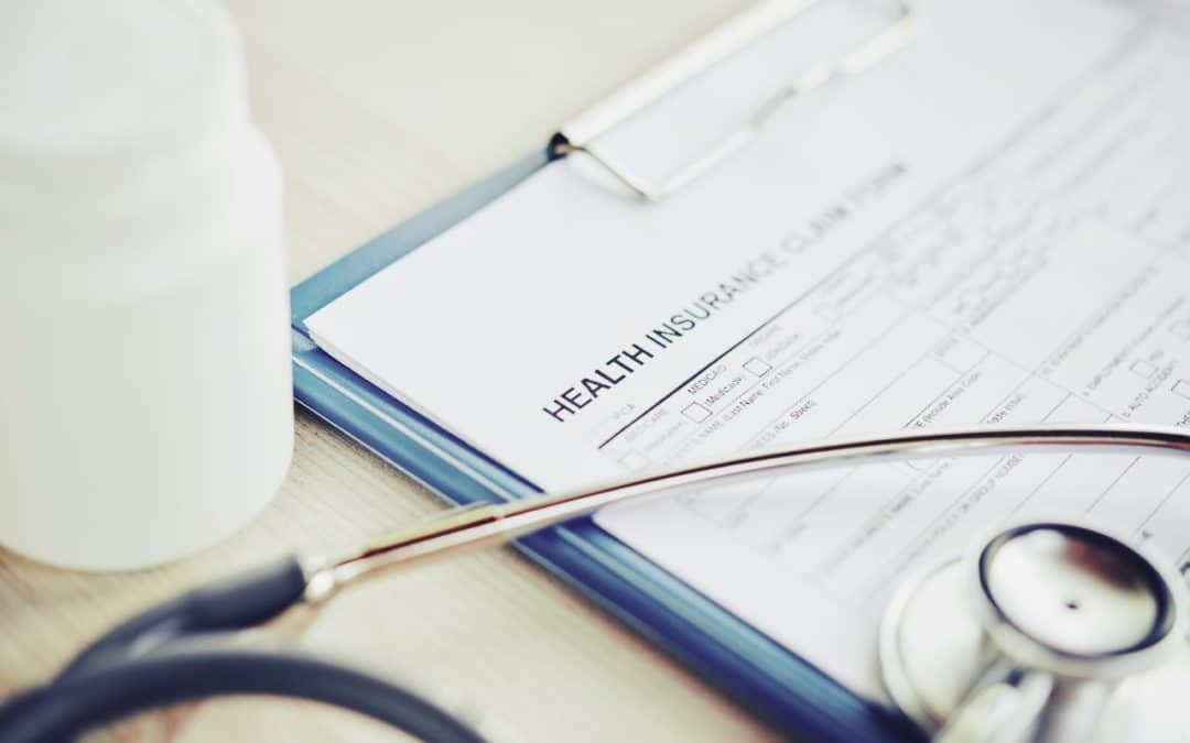 Employers mull health insurance surcharges for unvaccinated